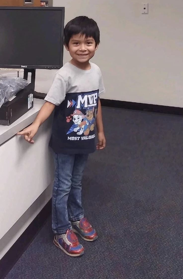 First grade student Issac in Chavez school office