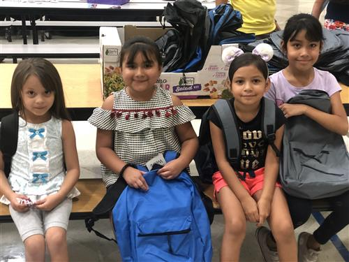 Chavez students with the backpacks donated by LULAC
