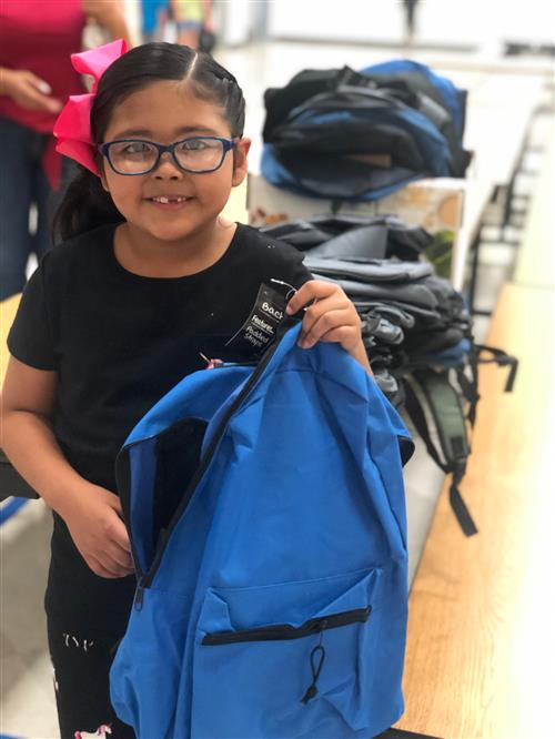 Chavez student with a new backpack from LULAC