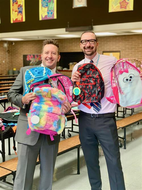 Maricopa County School Superintendent, Steve Watson, and I.G. Conchos Principal, Dr. Roat, with donated backpacks